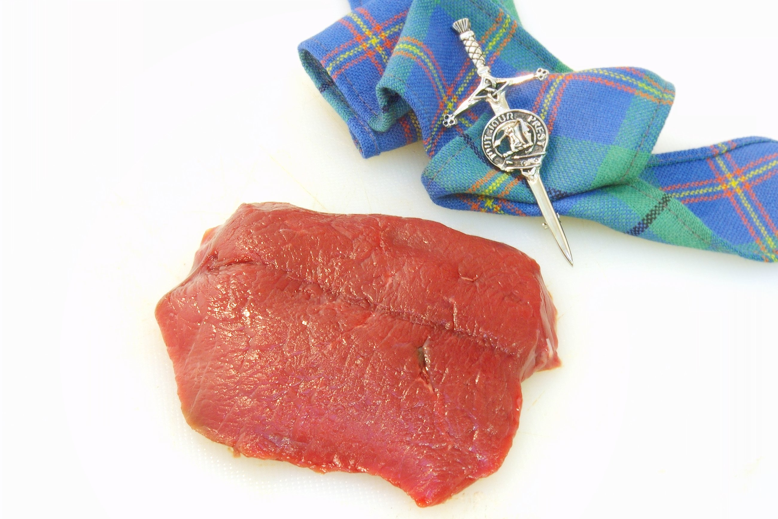 A raw venison sirlion steak